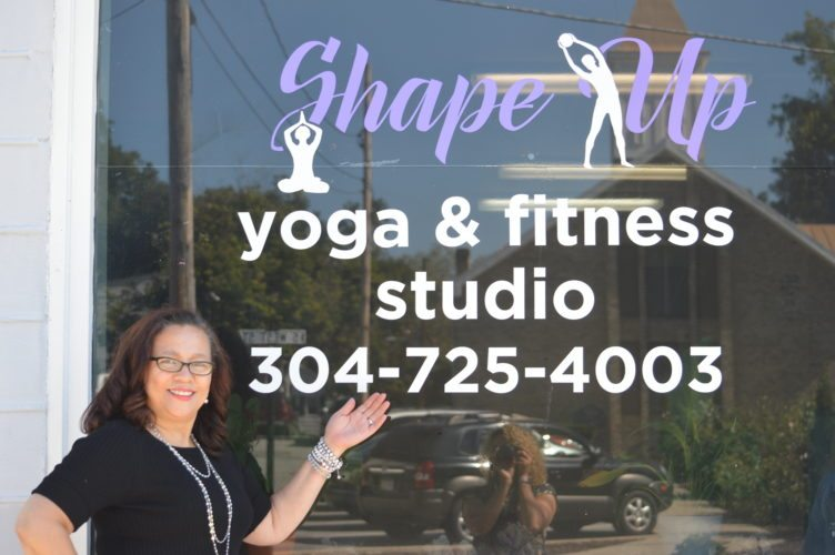 Owner Tammy Crockett stands outside of her Yoga and Fitness Studio, Shape Up. (Journal photo by Adranisha Stephens)