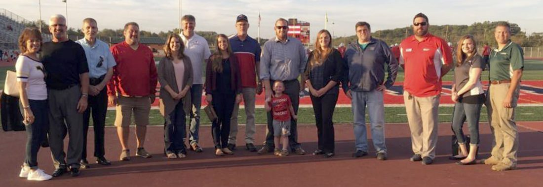 Spring Mills High School's athletic sponsors pose during an event before last Friday's home football game in Spring Mills. (Journal photo by Jess Manuel)