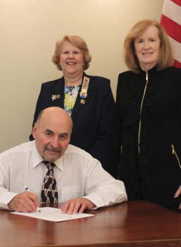 Mayor Jim Auxer signing proclamation for Constitution Week with, left, Regent Kathy Sholl and First Vice Regent Patricia Toffling. (Submitted photo)