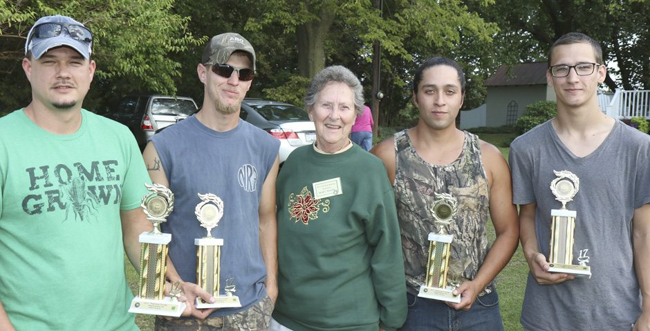 The first place team members are Derrick, Jesse, Matt Reese and Enrico Richardson, and, in the center, is Road Master Mary Wolfe. (Submitted photo)