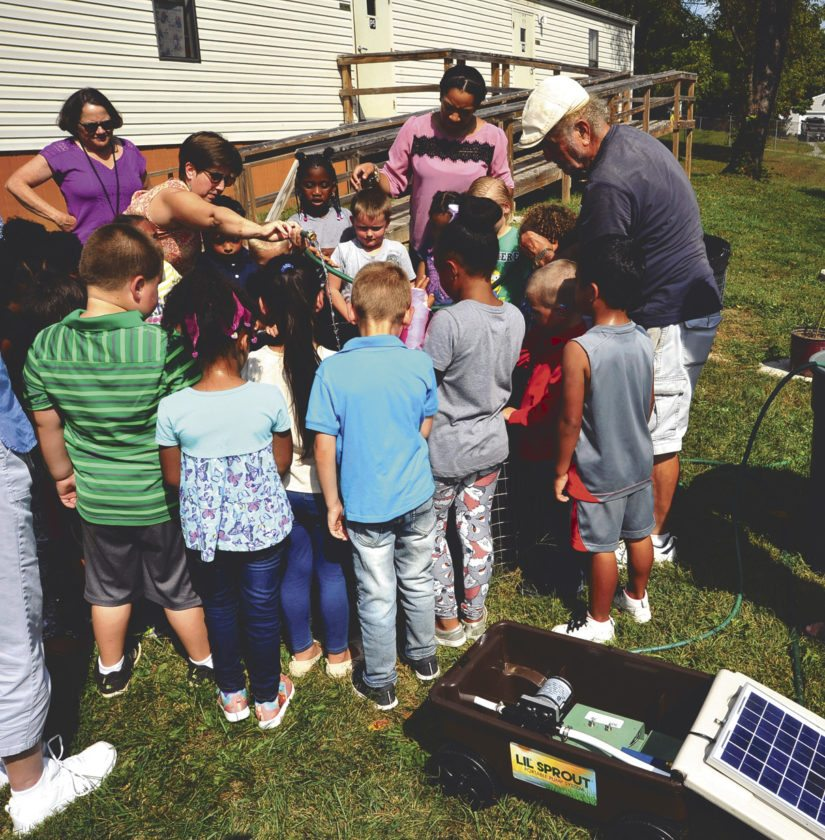 "Roger Either demonstrates the ""Lil' Sprout"" solar water pump to students at Ranson Elementary School on Tuesday. (Journal photo by Jeff McCoy)"