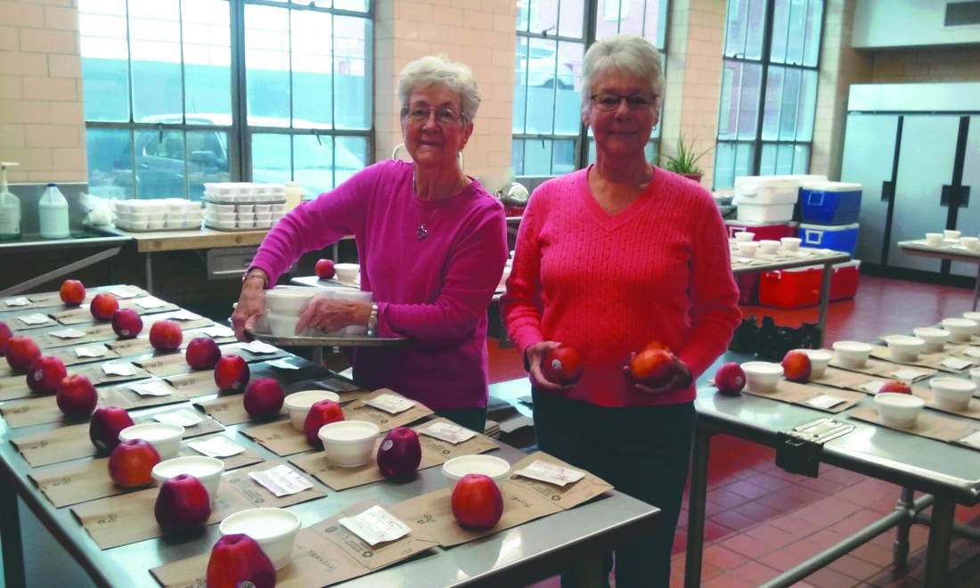 Charlyn Ely (L) and Carolyn Hofe (R) are volunteers in the kitchen of Meals On Wheels and also serve as volunteer drivers to deliver the meals to homebound members of the community.