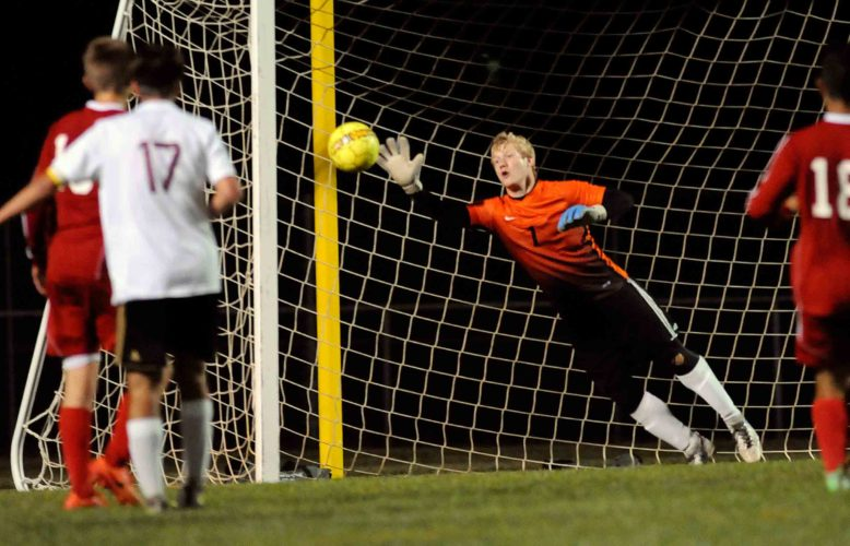 Washington goalkeeper Cameron Heustis makes a diving save on a shot on goal from Jefferson's Matthew Baker late in the first half Thursday night. See more photos on CU.journal-news.net. (Journal photo by Ron Agnir)