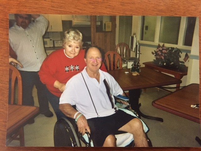 Judi Thomas pushes her husband Randy in a wheelchair prior to his passing in 2010. (Submitted photo)