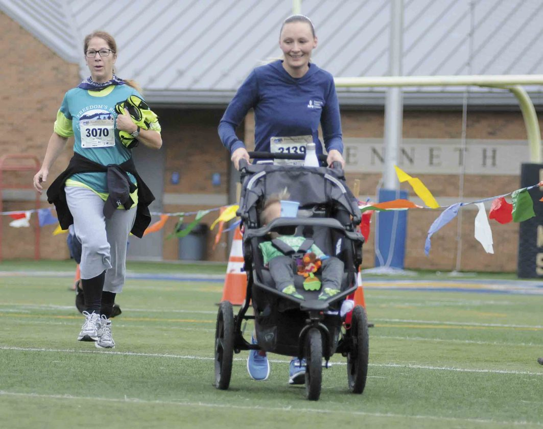 Journal photo by Ron Agnir Charles Town's Amber Householder pushes a double stroller during the event.