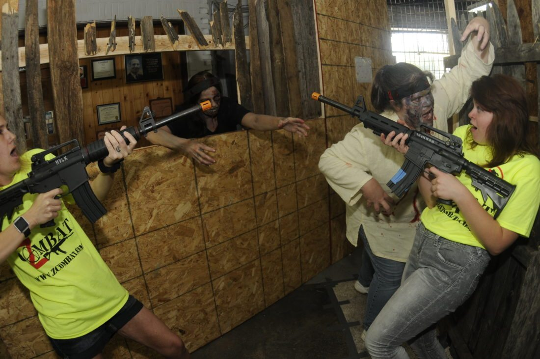 Jaimi Coomes looks on in horror as Abbie Woodard is attacked by zombie Lara Woodard at ZCombat HQ. (Journal photo by Ron Agnir)