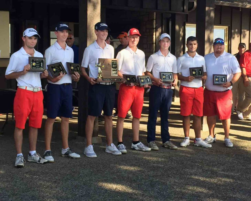 Celebrating Washington's Class AAA state team championship in golf are, from left:Tanner Elliott, Christian Boyd, Tyler Hardy, Mason Kidwell, Christopher Neighbors, Gavin Bonievich and coach Rusty Staubs. It is the school's first state team championship. (Photo by Kevin Hardy)