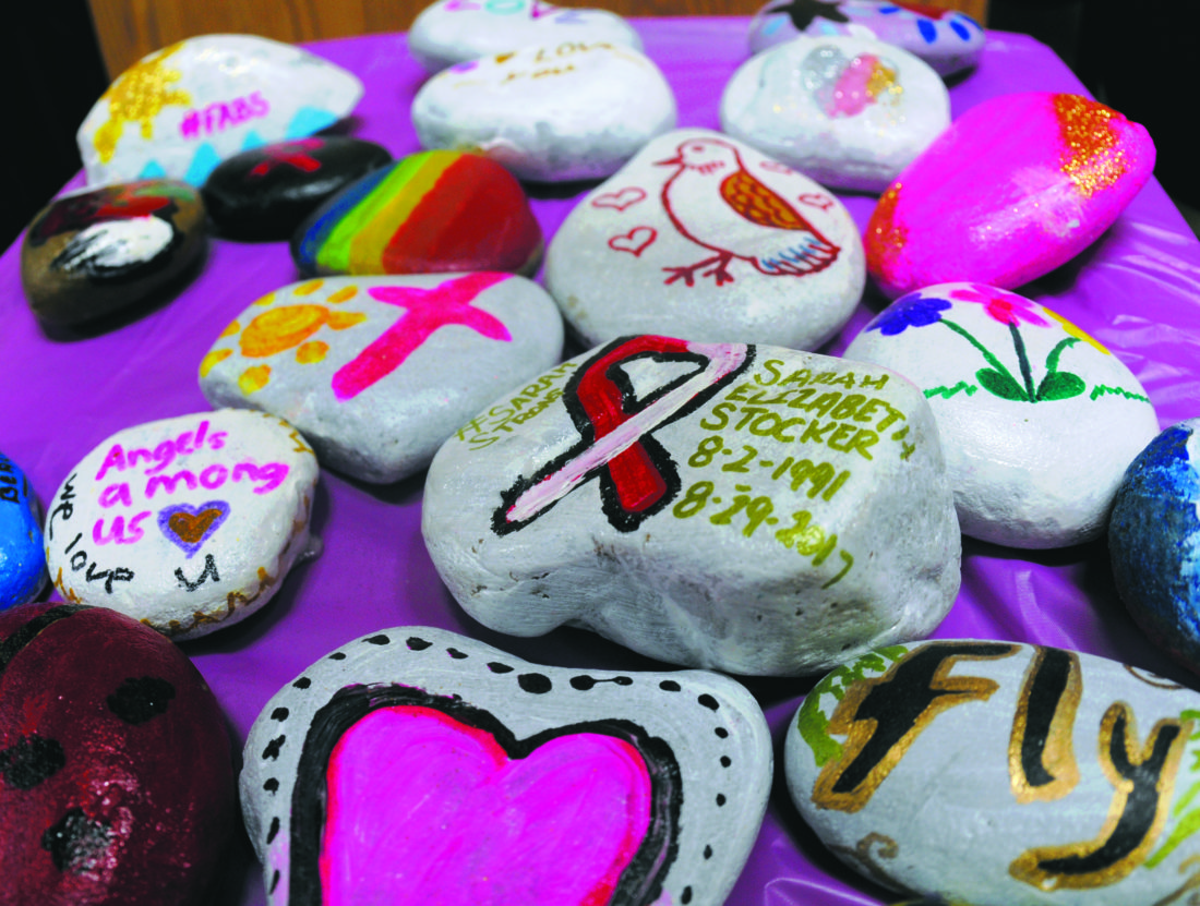 06 CelebrateSarah2 ra 10-05-17 Hand painted remembrance stones made by students and staff that will be place around a recently planted tree in memory of Sarah Stocker Thursday evening at Berkeley Heights Elementary School. (Journal Photo by Ron Agnir)