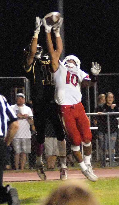 Journal photo by Eric Jones Spring Mills' Trenton Kerns, left, breaks up a pass intended for Jefferson's Scooter Gaskins during their game on Friday.