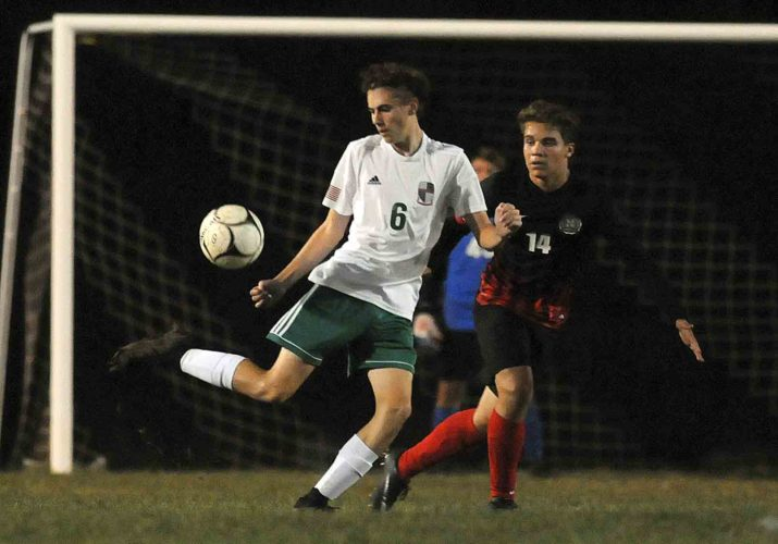 Musselman's Zack Kessler, left, controls the ball in front of Spring Mills' Alex Inman during first-half action of their game Tuesday evening in Inwood. See more photos on CU.journal-news.net.