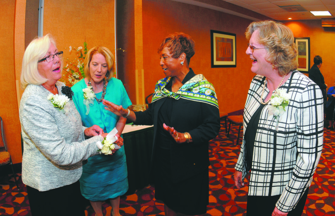 From left: Peggy Smith, Becky Stotler, Faye Fields, President/Board Chai-Girl Scouts Nation's Capital and Part Owner of the Washington Nationals Major League Baseball Team and  Vicki Jenkins chat just before the Women of Distinction Program Wednesday morning in Martinsburg. (Journal Photo by Ron Agnir)