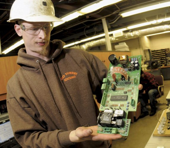 """James Rumsey Technical Institute, which already provides student instruction in fields such as electro-mechanical technology (as pictured here with JRTI student Josh Everson repairing a $250-$300 circuitboard), is looking to start a 3-D printer technology program — to be based in an """"Innovation Center"""" at school — by the fall of 2018, school officials said Wednesday at the Berkeley County Economic Development Authority board of directors meeting Wednesday. (Journal file photo by Ron Agnir)"""