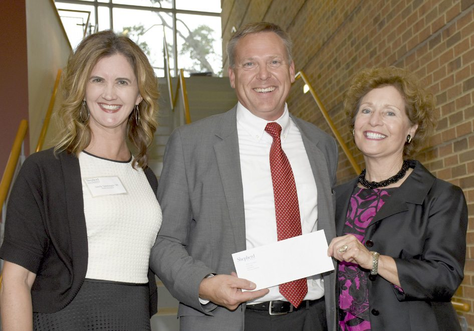 The Shepherd University Alumni Association recently presented a check for new band uniforms to Dr. Scott Hippensteel, associate professor of music and director of bands. Pictured, from left, are Sandy Sponaugle, Alumni Association president; Hippensteel; and Dr. Mary J.C. Hendrix, Shepherd president. (Photo courtesy of Shepherd University)