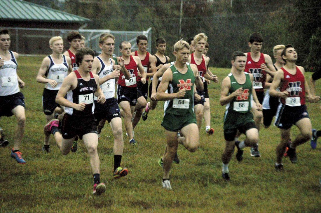 ane Braithwaite (71)of Spring Mills gets out early in the Eastern Panhandle Athletic Conference cross country race on Wednesday. He's joined near the front by Musselman's Asher Personett (64). (Journal photo by Jessica Manuel-Wilt)