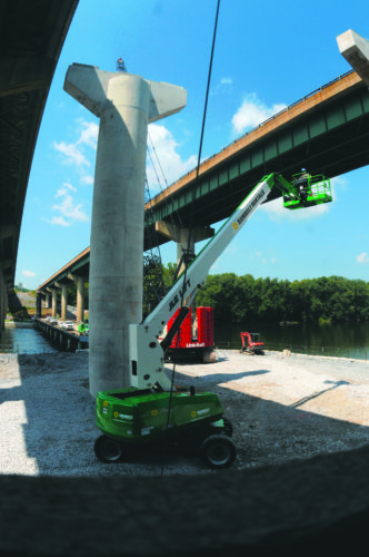 17 I-81Bridge3 ra 08-16-17  A bridge construction worker in a crane  goes up next to one of the new pillars for the new lanes across the Potomac River Wednesday afternoon. (Journal Photo by Ron Agnir)