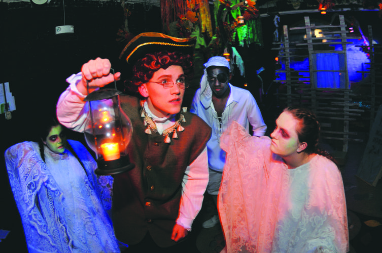 """20 MartHS Sleepy Hollow2 ra 10-18-17 Ichabod Crane (Tanner Boeckmann)  looks around as he is stalked by ghosts Mary Power, Kevin Scott and Hannah Bell in """"The Legend of Sleepy Hollow"""" by the Martinsburg High School Thespain Troup 502. Shows are Oct 21, 27, 28@ 7Pm and Oct 22@ 2PM. (Journal Photo by Ron Agnir)"""