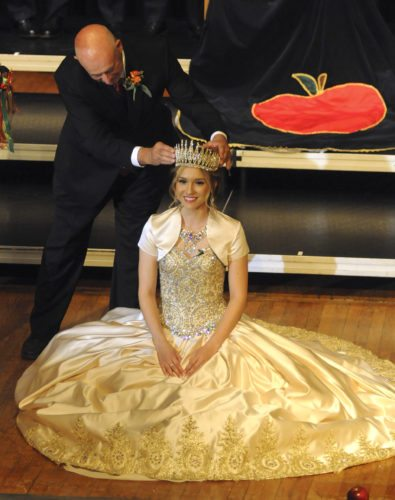 21 MSAHF-Coronation1 ra 10-20-17 Kent leonhardt, West Virginia Commissioner of Agriculture, crowns Queen Pomona XXXVIII Lauren Renee Riner, Friday night at the Mountain State Apple Harvest Festival Coronation in Martinsburg.. See more photos on CU.journal-news.net. (Journal Photo by Ron Agnir)