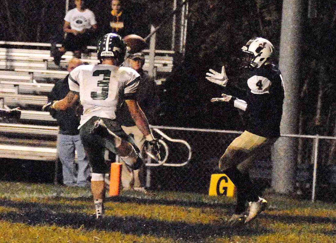 Journal photo by Rick Kozlowski Hampshire's Logan Clower, left, can't stop Hedgesville's Niyjere Smith from hauling in a touchdown pass Friday in Hedgesville. See more photos on CU.journal-news.net. (Journal photo by Rick Kozlowski)