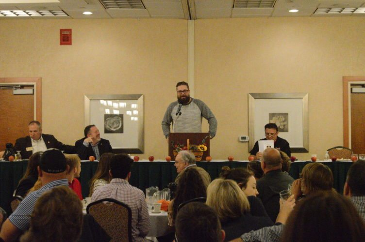Journal photo by Jessica Manuel Former West Virginia running back Owen Schmitt speaks to the crowd at Saturday's Bob Elmer Celebrity Sports Breakfast in Martinsburg.