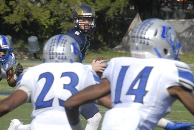 Journal photo by Rick Kozlowski Shepherd quarterback Connor Jessop, back, finds running room on his way to the end zone during the Rams' win over Urbana on Saturday in Shepherdstown.
