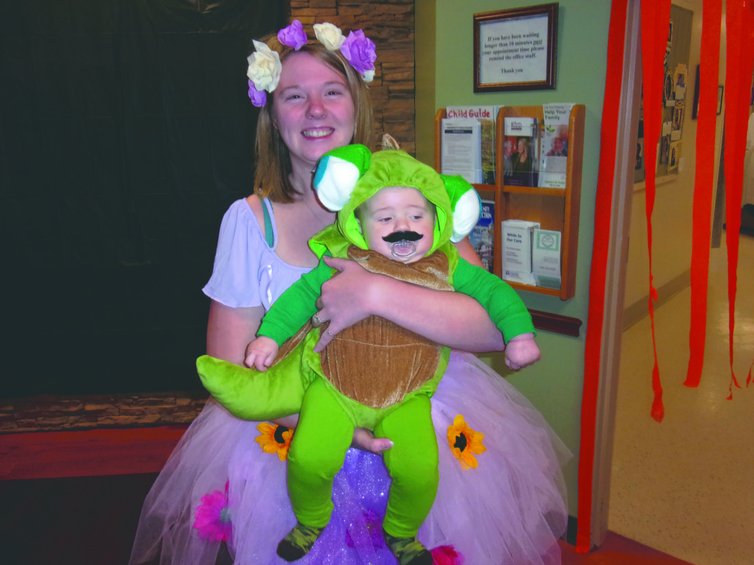 """Journal photos by John McVey Tessa Dockeney, above, of Gerrardstown with 4-month-old Wyatt at the Rehab Family Halloween Party on Friday evening. She is dressed as Rapunzel and he is dressed as Pascal from the movie """"Tangled."""""""