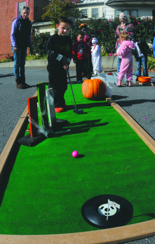 29 Shep Boofest7 ra 10-28-17 Gionni Genovese, 4 yrs old, plays Haunted Putt Putt on King Street at the Shepherdstown Boofest 2017 Sat morning. (Journal Photo by Ron Agnir)