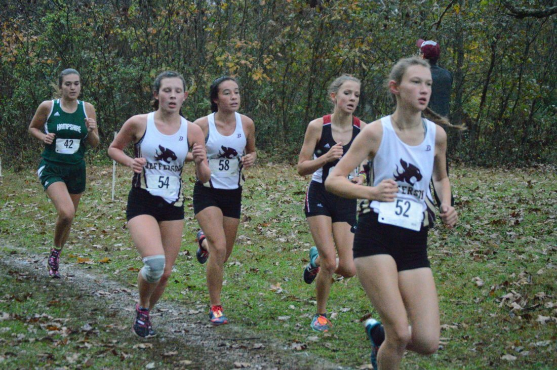 It's a group of girls from the Eastern Panhandle bunched together during the Class AAA state meet race on Saturday. They are, from left, Jada Fout of Hampshire, Morgan May and Vanessa Pratt of Jefferson, Blake Hull of Spring Mills and Taylor Blanchette of Jefferson. (Journal photo by Jessica Manuel-Wilt)