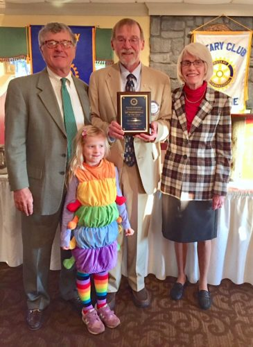 Shown, from left, are Bob McMillan, Shepherdstown Rotary Club President Walt Eifert, and Tia McMillan, right. In the foreground is the McMillan's granddaughter Liza, 5, who attended the breakfast with her granparents in her Halloween costume (a caterpillar). (Submitted photo)