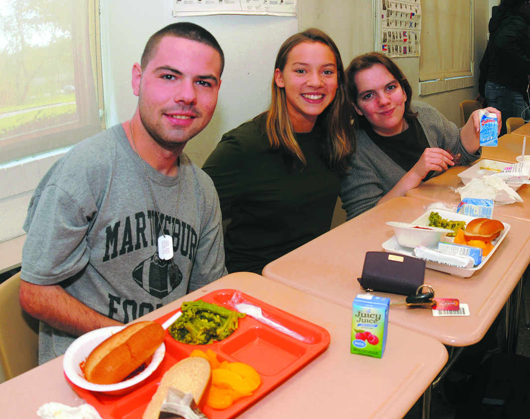 03 Lunch Buddies1 ra 11-02-17 From left: High School seniors Josh Waltz, Katie Roemer and Brenda Bruno enjoy lunch together Thursday as part of the seven year old Lunch Buddies Program at Martinsburg High School. (Journal Photo by Ron Agnir)