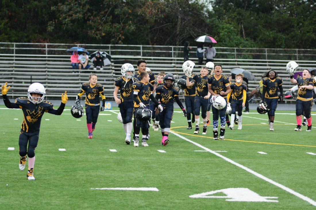 The 11U West Virginia Elite football team celebrates after winning the Northern Virginia American Youth Football conference championship recently.