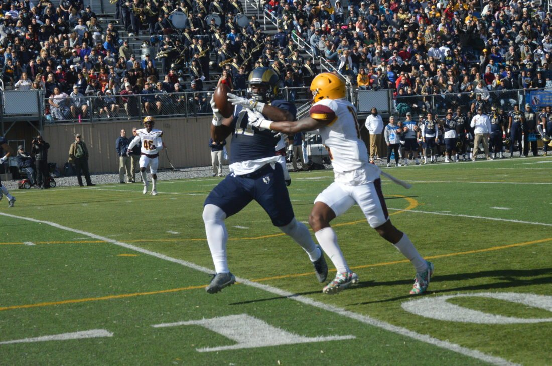Journal photo by Jessica Manuel-Wilt Shepherd's D.J. Cornish catches a pass while being defended by Charleston's Cedric Amadi during their game on Saturday in Shepherdstown.