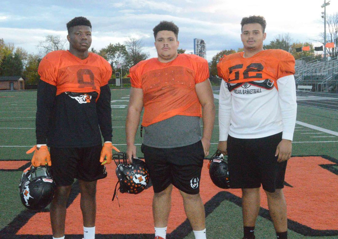 Pictured above from left to right are Martinsburg defensive linemen Tavis Lee, Trey Henry and Jalen Hesen. The defensive line has been crucial in the Bulldogs' success this season as they look ahead to the opening round of the Class AAA state playoffs.