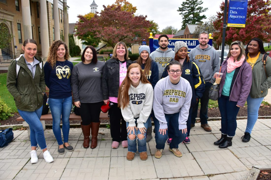 Students from Department of Psychology adolescent development class who recently did a service-learning project with seventh grade students from Harpers Ferry Middle School and Shepherdstown Middle School are, front row (l.-r.) Jillian Belcher, psychology major, Haymarket, Maryland; and Caroline Shamberger, psychology major, Morgantown. Back row, Kelsie Weaver, psychology, York, Pennsylvania; Alyssa Butler, psychology, Elkton, Virginia; Brooke Reaves, political science, Charles Town; Dr. Heidi Dobish, associate professor of psychology; Tiffany Heerd, biology, Hedgesville; Ryan Garman, R.B.A., Martinsburg; Temetrie Whaley Encarnacion, R.B.A., Long Island, New York; Bill Leckemby, sociology, Sterling, Virginia; Aleah Backstrom, business administration, Berkeley Springs; and Kydadah Alexander, psychology, Washington, D.C. Not pictured is Alejandro Campero Oliart, psychology, Germantown, Maryland. (Photo courtesy of Shepherd University)