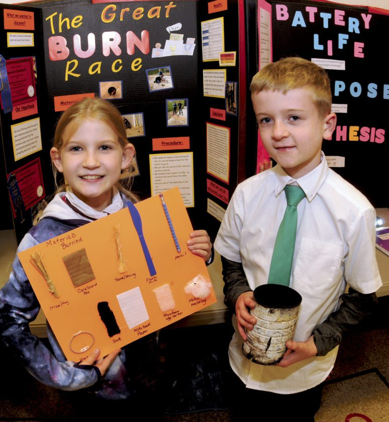 Fourth Graders George Sutherland and Garrett Glassford show their project at the 40th annual science fair Wednesday. (Journal Photo by Ron Agnir)