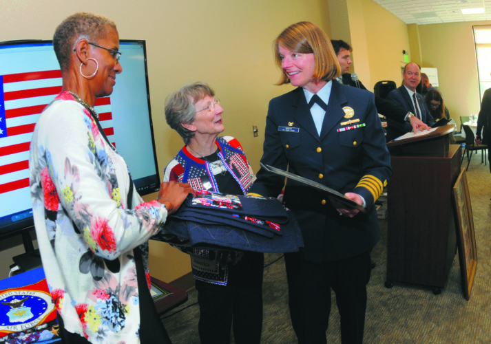 Journal photos by Ron Agnir Paula Hall, left, and Sue Moats of Quilts of Valor congratulate Capt. Kirsten Martin  at The Journal's 2017 Unsung Heroes luncheon on Wednesday, in Kearneysville. Journal photo by Ron Agnir