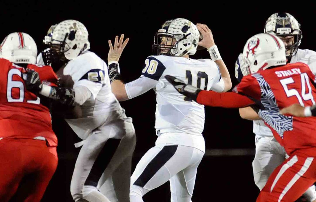 Journal photo by Ron Agnir Hedgesville quaterback Jason Plotner has plenty of time to pass the ball in last week's win over Spring Mills. (Journal photo by Ron Agnir)