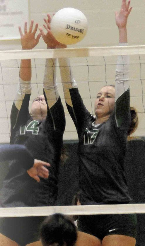 Musselman's Sarah Wright, left, and Rachael Ratliff go up for a block. (Journal photo by Ron Agnir)