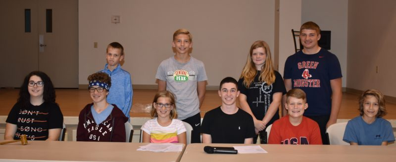 The officers elected for the 2017-2018 Club year are, from left, Hailey Martz, president; Josiah Wink, vice president; Audrey Hasley, recording secretary; Seth Tyson, corresponding secretary; Conner Chancey, treasurer; Mikayla Schlotthober, historian; standing, Colin Frye, reporter; Chandler Meske, game leader; Alyssa Gain, song leader; and Bradley Meske, song leader. Absent from picture are: Cole Horner, Health H; Blake Butler, HOW! HOW! leader; and Macey Butler, song leader. (Submitted photo)