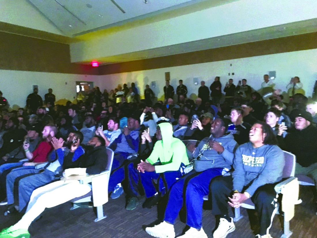 Members of the Shepherd football team along with coaches and fans watch the NCAADivision IIFootball Selection Show on Sunday. The Rams earned the second seed in Super Region 1.