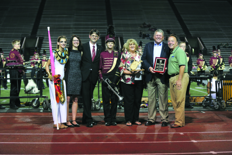 12MarchBand HOF 10-21-17 From left: Anna Lynch, Dawn Lynch, J.P. Lynch, Emma Lynch Rosemary Lynch, John Lynch and Randall Reid-Smith. WV Comissioner of the Division of Culture and History presenting John Lynch Sr. wit the 2017 Band Director Hall of Fame Plaque at Laidley Field in Charleston, WV Oct. 21, 2017. (Submitted Photo by Marcus Constantino)