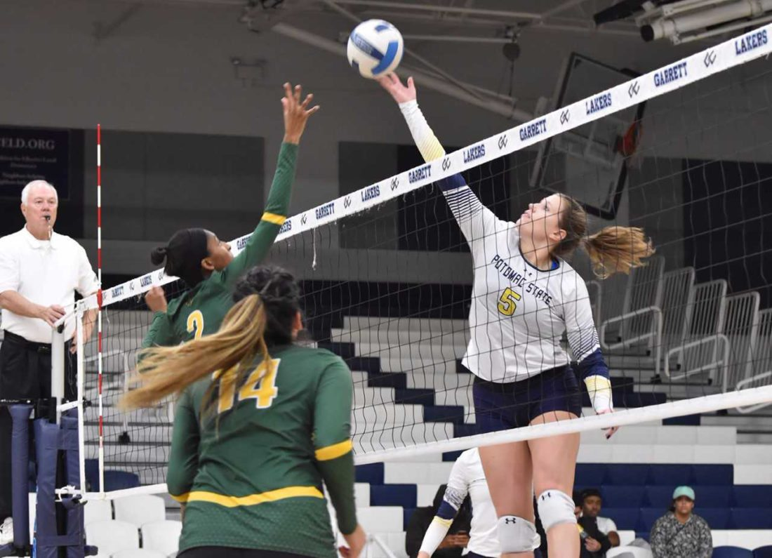 Brittney Hozdic, right, tips the ball over the net as part of the Potomac State volleyball team, which recently won the Region XXtournament. Hozdic, who played for Jefferson, was named tournament MVP as the Catamounts earned the tournament title.
