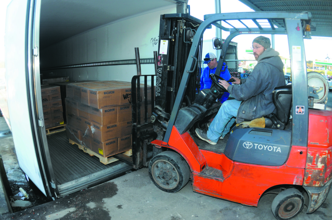17 Food Donation1 ra Roger Myers unloads a pallet of donated food Thursday morning in Martinsburg. On Thursday, November 16, 2017, at 8:00 a.m., the Berkeley County Congregational Cooperative Action Project (CCAP) Loaves and Fishes Food Pantry will receive a semi-truck of food from The Church of Jesus Christ of Latter-day Saints (LDS Church). The truckload will contain approximately 40,000 pounds of food, with an estimated value of $40,000. (Journal Photo by Ron Agnir)