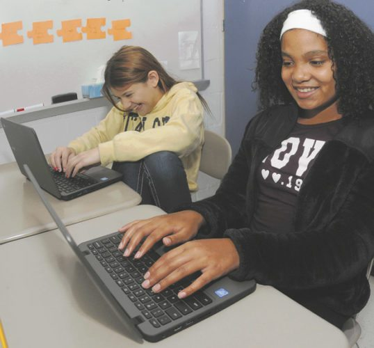 """16 North MS Tech3 ra 11-14-17 From left: North Middle School 6th graders Alexis Grady and Akyra Seifert answer questions on a quiz about Intensive Pronouns using their school supplied iPads and Google Chrome Notebooks using the interactive educational program""""NearPod""""  Tuesday morning in Martinsburg. (Journal Photo by Ron Agnir)"""