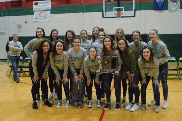 Journal photo by Jessica Manuel-Wilt The Musselman volleyball team poses with the Class AAA state championship trophy during a pep rally on Friday.