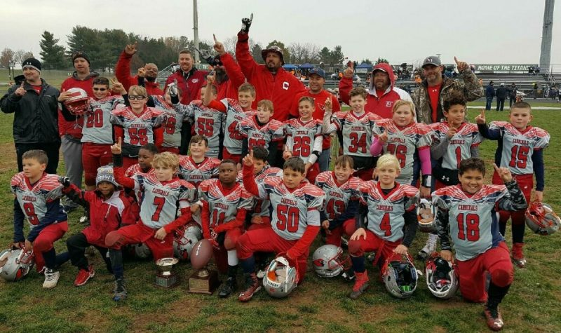 The Pony Junior Cardinals pose after winning the Mountain Valley Youth Football League championship for the second straight year over the weekend.