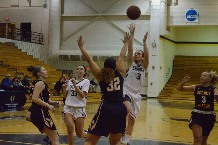 Shepherd's Morgan Arden, right, shoots over Goldey-Beacom's Jill Latanowich during their game on Nov. 14 at the Butcher Center.