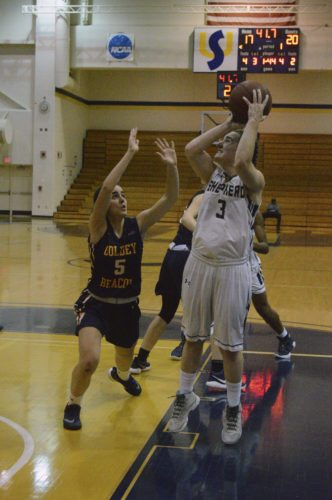 Journal photo by Jessica Manuel-Wilt Shepherd's Morgan Arden, right, shoots over Goldey-Beacom's Maya Poch during their game on Nov. 14.