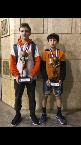 Submitted photo Patrick Jackson, left, and Matthew Dolan pose with their trophies after placing second recently in the Tulsa Kickoff Classic wrestling tournament in Oklahoma.