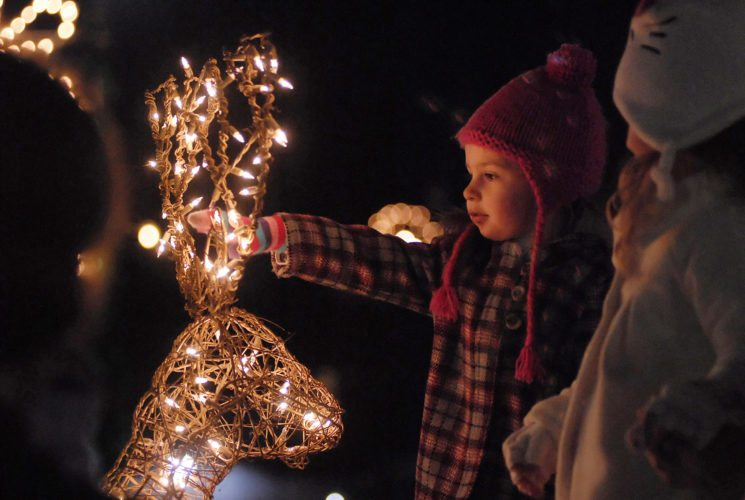 01 TreeLight-Reindeer ra 11-30-12 Emma Price, 2 1/2 yrs old re-discovers the magic of Christmas in downtown Martinsburg during the Christmas Tree  Lighting Ceremony Friday night.  (Journal photo by Ron Agnir)