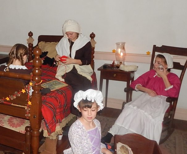 Girls dressed in period clothing participate in the 2016 Colonial Christmas at the General Adam Stephen House. (Submitted photo)